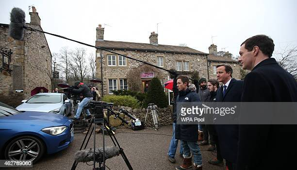 Chancellor Of The Exchequer George Osborne and Prime Minister David Cameron watch a scene being filmed on the set of television series Emmerdale on...