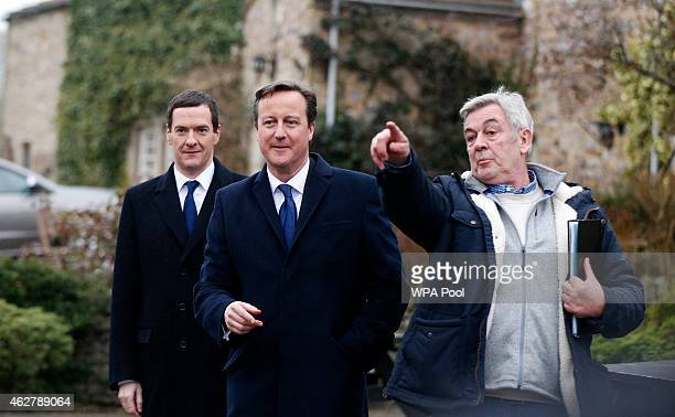Chancellor Of The Exchequer George Osborne and Prime Minister David Cameron with director Peter Rose on the set of television series Emmerdale on the...