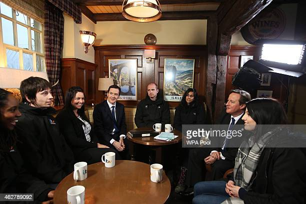 Chancellor Of The Exchequer George Osborne and Prime Minister David Cameron speak to apprentices in The Woolpack pub during a visit to the set of...