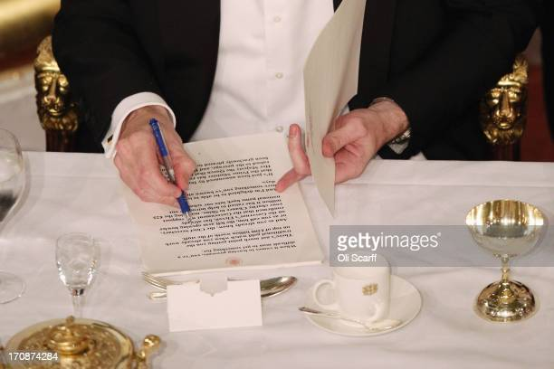 Chancellor of the Exchequer George Osborne annotates his speech before addressing the audience of the 'Lord Mayor's Dinner to the Bankers and...