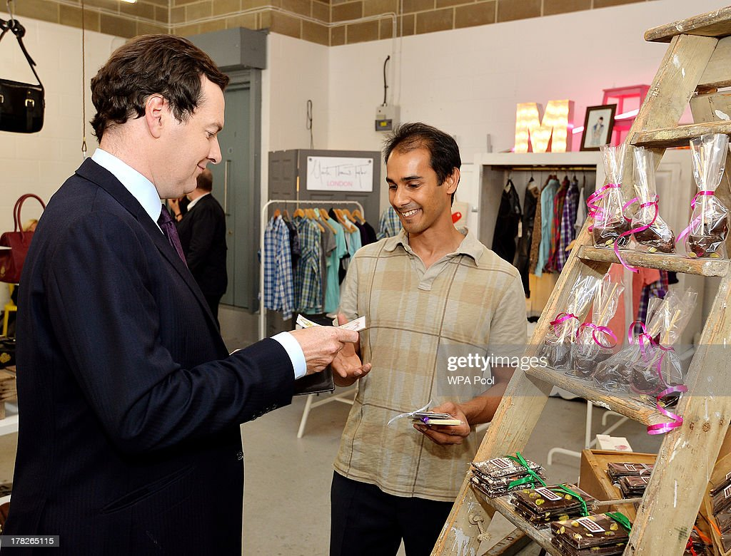 Chancellor of the Exchequer George Osborne buys some Ubuntu Chocolate from owner Jeremy Wickremer, during a visit to a pop up shop where ten new small companies are trying to produce growth and become established, on August 28, 2013 in Piccadilly, London.