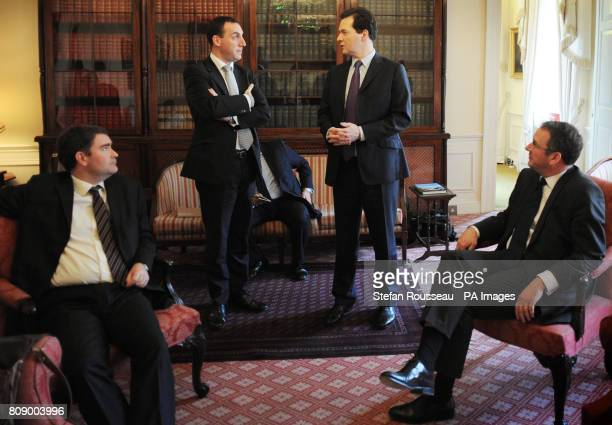 Chancellor of the Exchequer George Osborne chats with Dan Rosen Field as Mark Hoban right looks on before leaving No11 Downing Street to pose for...