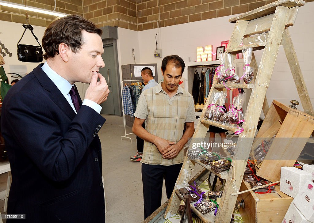 Chancellor of the Exchequer <a gi-track='captionPersonalityLinkClicked' href=/galleries/search?phrase=George+Osborne&family=editorial&specificpeople=5544226 ng-click='$event.stopPropagation()'>George Osborne</a> eats some Ubuntu Chocolate watched by owner Jeremy Wickremer, during a visit to a pop up shop where ten new small companies are trying to produce growth and become established, on August 28, 2013 in Piccadilly, London.