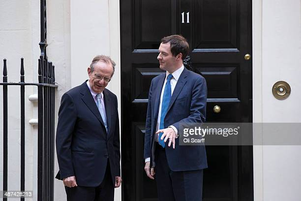 Chancellor of the Exchequer George Osborne greets Italian Finance Minister Pier Carlo Padoan in front of Number 11 Downing Street on April 30 2014 in...