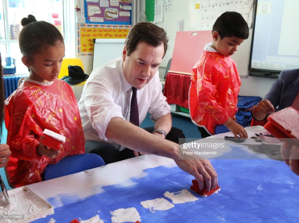Chancellor of the Exchequer <a gi-track='captionPersonalityLinkClicked' href=/galleries/search?phrase=George+Osborne&family=editorial&specificpeople=5544226 ng-click='$event.stopPropagation()'>George Osborne</a> helps paint a picture of Canary Wharf during a visit to Old Ford Primary School on June 25, 2013 in London, England. Tomorrow Mr Osborne will announce the Government's spending review for 2015-1016. Earlier the Chancellor announced that spending on schools will be ring fenced.