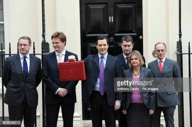 Chancellor of the Exchequer George Osborne holds his ministerial box as he leaves 11 Downing Street London with other members of the Treasury team...