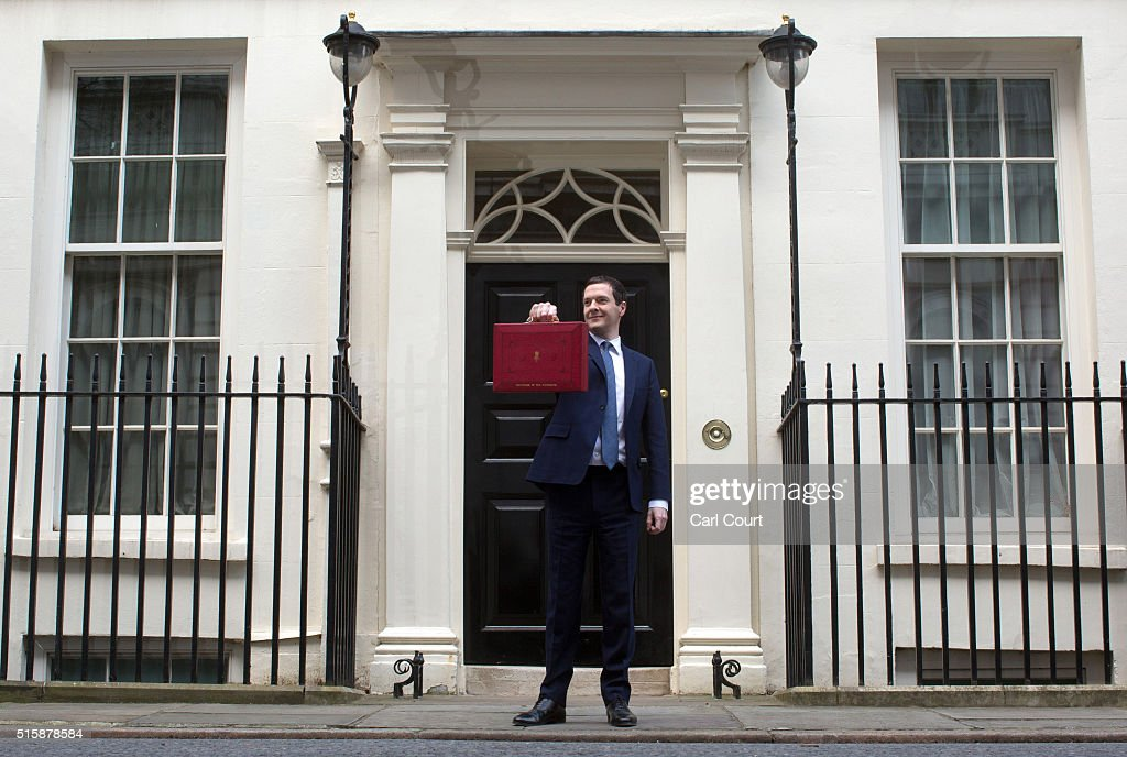 Chancellor of the Exchequer George Osborne holds his ministerial red box up to the media as he leaves 11 Downing Street on March 16, 2016 in London, England. The Chancellor will deliver the next Budget today, where he will state that he needs to cut 50 pence in every £100 that the Government spends by 2020.