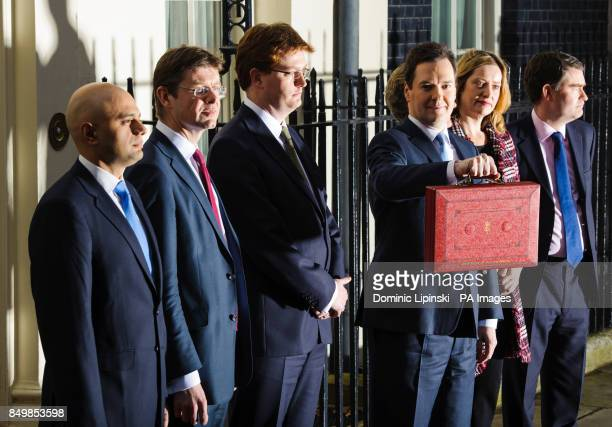 Chancellor of the Exchequer George Osborne holds his red dispatch box as he stands with the Treasury team Economic Secretary to the Treasury Sajid...