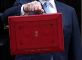 Chancellor of the Exchequer George Osborne holds poses before presenting his annual budget to Parliament outside 11 Downing Street on March 20 2013...