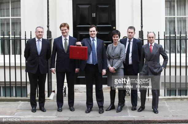 Chancellor of the Exchequer George Osborne holds up his red Ministerial Box outside 11 Downing Street with his Treasury team Financial Secretary to...