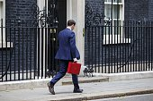 Chancellor of the Exchequer George Osborne is seen outside 11 Downing Street in London England before presenting his summer budget to Parliament on...