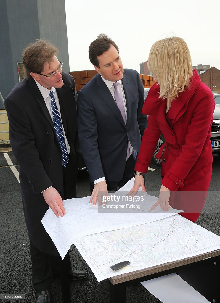 Chancellor of the Exchequer <a gi-track='captionPersonalityLinkClicked' href=/galleries/search?phrase=George+Osborne&family=editorial&specificpeople=5544226 ng-click='$event.stopPropagation()'>George Osborne</a> looks at maps of the proposed HS2 route with HS2 Senior route engineer Amanda White and Matthew Colledge (L) of Trafford Council, outside Manchester Piccadilly Station on January 28, 2013 in Manchester, England. The government has today released details of the next phase of the GBP 32 billion HS2 high-speed rail network, which will link Manchester and Leeds.