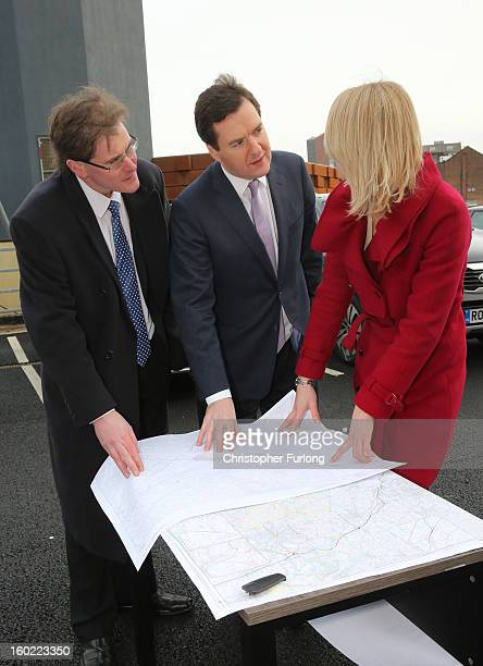 Chancellor of the Exchequer George Osborne looks at maps of the proposed HS2 route with HS2 Senior route engineer Amanda White and Matthew Colledge...