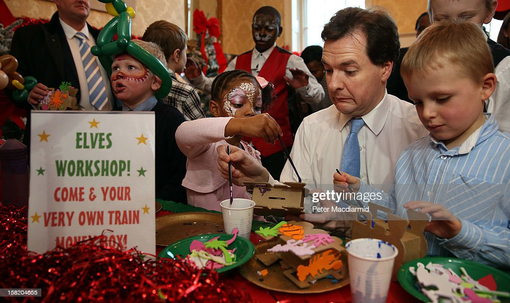 Chancellor of the Exchequer <a gi-track='captionPersonalityLinkClicked' href=/galleries/search?phrase=George+Osborne&family=editorial&specificpeople=5544226 ng-click='$event.stopPropagation()'>George Osborne</a> paints a money box with children at Number 11 Downing Street on December 11, 2012 in London, England. The Chancellor is hosting his yearly Christmas party for the Starlight charity.