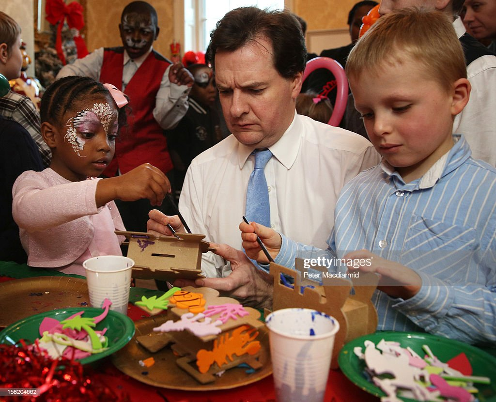 Chancellor of the Exchequer George Osborne paints a money box with children at Number 11 Downing Street on December 11, 2012 in London, England. The Chancellor is hosting his yearly Christmas party for the Starlight charity.