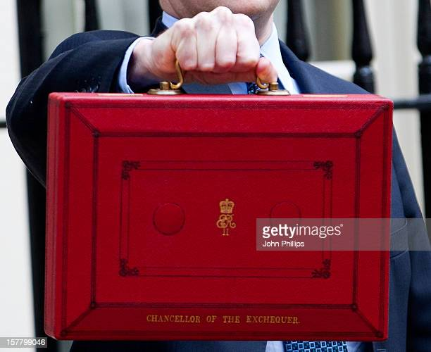 Chancellor Of The Exchequer George Osborne Poses For Photographers Outside 11 Downing Street In London Before Presenting His Annual Budget To...