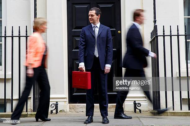 Chancellor of the Exchequer George Osborne poses for photographers outside 11 Downing Street in London England before presenting his annual budget to...