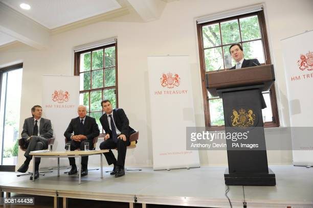 Chancellor of the Exchequer George Osborne speaking at the Treasury in central London watched by John Whiting Michael Jack and David Gauke where he...