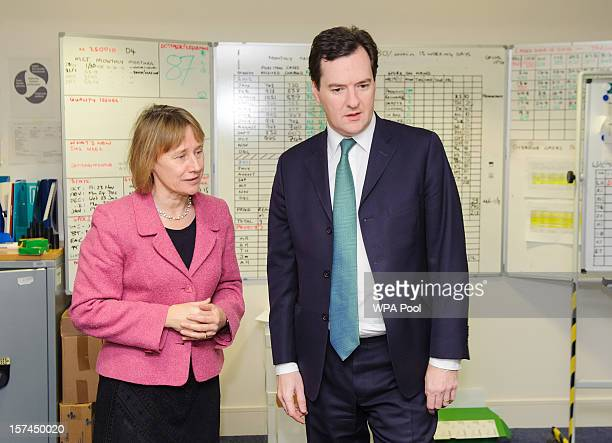 Chancellor of the Exchequer George Osborne speaks to Head of HMRC Lin Homer during a visit to the offices of HM Revenue Customs ahead of his...