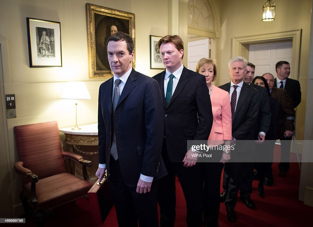 Chancellor of the Exchequer <a gi-track='captionPersonalityLinkClicked' href=/galleries/search?phrase=George+Osborne&family=editorial&specificpeople=5544226 ng-click='$event.stopPropagation()'>George Osborne</a> (L) stands with Chief Secretary to the Treasury <a gi-track='captionPersonalityLinkClicked' href=/galleries/search?phrase=Danny+Alexander+-+Politician&family=editorial&specificpeople=6897330 ng-click='$event.stopPropagation()'>Danny Alexander</a> (2L) and the rest of his treasury team inside number 11 Downing Street before leaving for Parliament on March 18, 2015 in London, England. The Chancellor is presenting his 5th Budget to Members of Parliament today, the last before the General Election on May 7, 2015.
