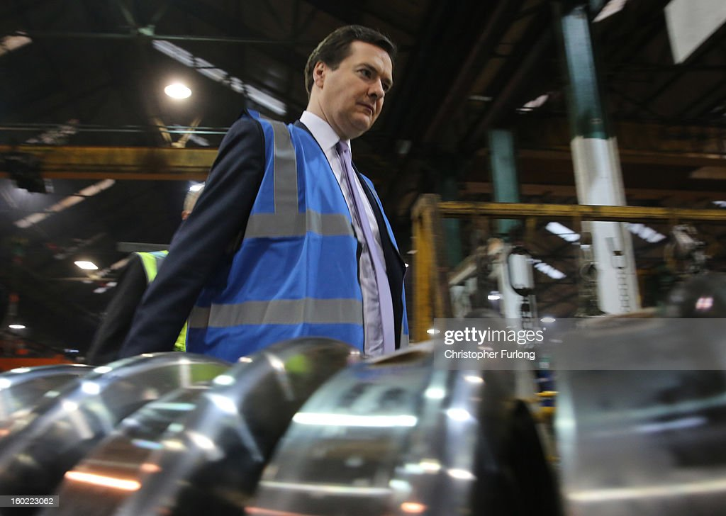 Chancellor of the Exchequer George Osborne takes part in a tour of the train wheel manufacturers Lucchini UK, at Trafford Park on January 28, 2013 in Manchester, England. The government has today released details of the next phase of the GBP 32 billion HS2 high-speed rail network, which will link Manchester and Leeds.