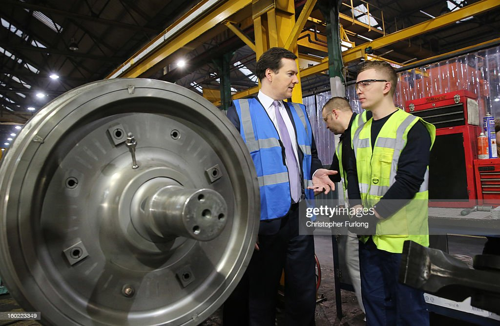 Chancellor of the Exchequer <a gi-track='captionPersonalityLinkClicked' href=/galleries/search?phrase=George+Osborne&family=editorial&specificpeople=5544226 ng-click='$event.stopPropagation()'>George Osborne</a> talks to workers as he takes part in a tour of the train wheel manufacturers Lucchini UK, at Trafford Park on January 28, 2013 in Manchester, England. The government has today released details of the next phase of the GBP 32 billion HS2 high-speed rail network, which will link Manchester and Leeds.