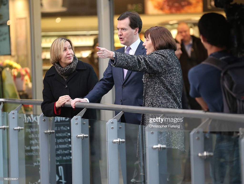 Chancellor of the Exchequer <a gi-track='captionPersonalityLinkClicked' href=/galleries/search?phrase=George+Osborne&family=editorial&specificpeople=5544226 ng-click='$event.stopPropagation()'>George Osborne</a> tours Manchester Piccadilly Station with Diane Crowther (L), Manging Director of Network Rail, and Alison Monroe, CEO of HS2, on January 28, 2013 in Manchester, England. The government has today released details of the next phase of the GBP 32 billion HS2 high-speed rail network, which will link Manchester and Leeds.