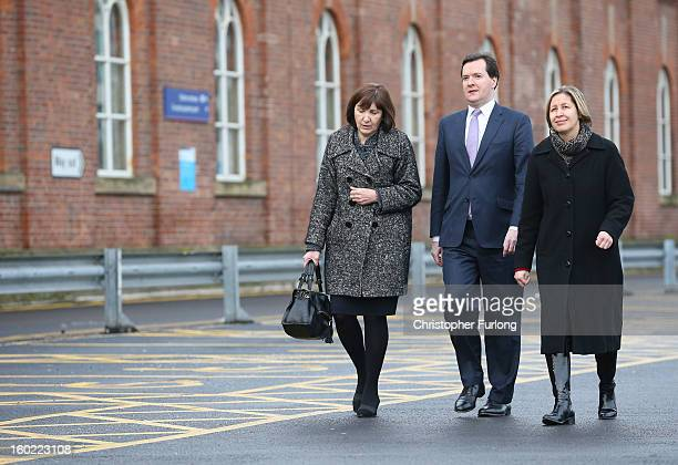 Chancellor of the Exchequer George Osborne walks along the proposed site for the HS2 platform at Manchester Piccadilly Station with Diane Crowther...