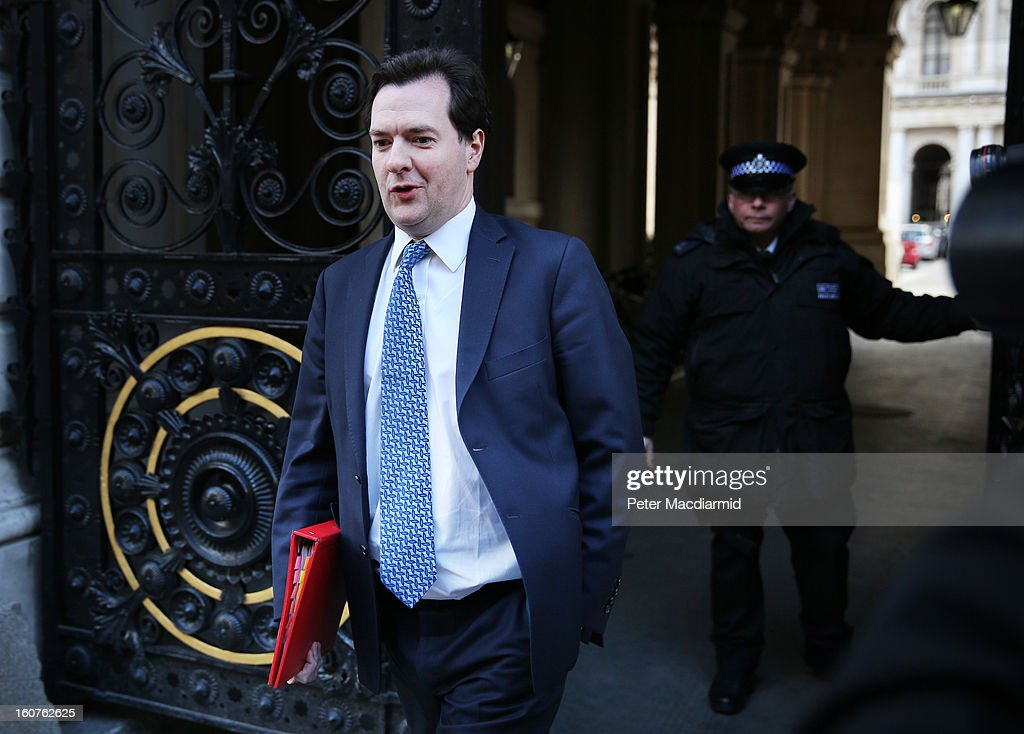 Chancellor of the Exchequer <a gi-track='captionPersonalityLinkClicked' href=/galleries/search?phrase=George+Osborne&family=editorial&specificpeople=5544226 ng-click='$event.stopPropagation()'>George Osborne</a> walks into Downing Street to attend a security meeting with US Vice President Joe Biden on February 5, 2013 in London, England. The Vice President has also met with German and French leaders during his visit to Europe.