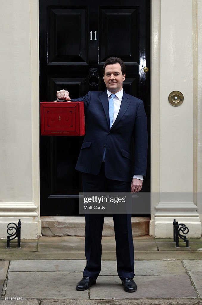 Chancellor of the Exchequer George Osborne walks out before presenting his annual budget to Parliament, at 11 Downing Street on March 20, 2013 in London, England. The Chancellor, under pressure after the UK lost its AAA credit rating last month and the lack of growth in the economy, is predicted to reveal plans to continue with his austerity strategy to cut the UK's deficit. It is likely that Mr. Osborne will announce further spending cuts to Whitehall departments with the savings put in place to boost large scale infrastructure projects, with both tax breaks on childcare and a rise in fuel duty also high on the agenda.