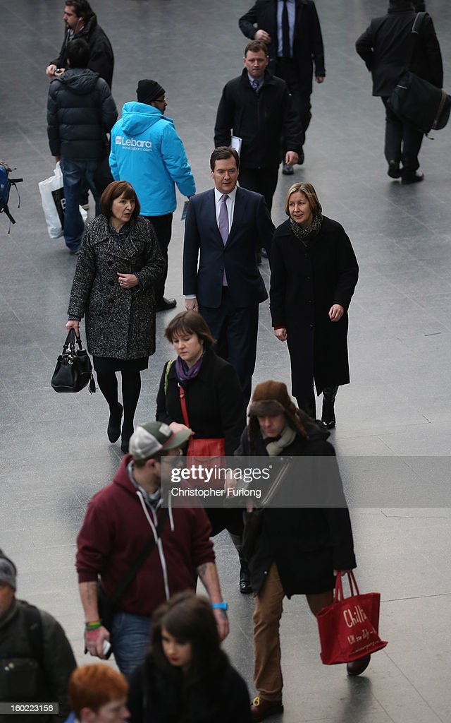 Chancellor of the Exchequer <a gi-track='captionPersonalityLinkClicked' href=/galleries/search?phrase=George+Osborne&family=editorial&specificpeople=5544226 ng-click='$event.stopPropagation()'>George Osborne</a> walks through Manchester Piccadilly Station with Diane Crowther (R), Manging Director of Network Rail and Alison Monroe, CEO of HS2, on January 28, 2013 in Manchester, England. The government has today released details of the next phase of the GBP 32 billion HS2 high-speed rail network, which will link Manchester and Leeds.