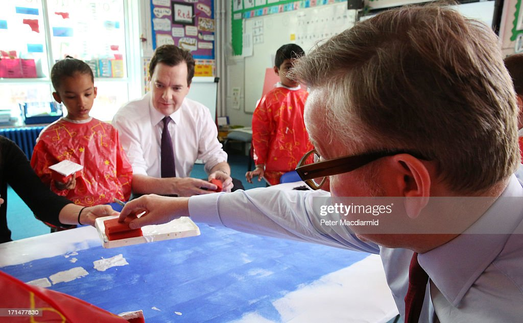 Chancellor of the Exchequer <a gi-track='captionPersonalityLinkClicked' href=/galleries/search?phrase=George+Osborne&family=editorial&specificpeople=5544226 ng-click='$event.stopPropagation()'>George Osborne</a> watches as Education Secretary <a gi-track='captionPersonalityLinkClicked' href=/galleries/search?phrase=Michael+Gove&family=editorial&specificpeople=2223709 ng-click='$event.stopPropagation()'>Michael Gove</a> (R) helps paint a picture of Canary Wharf during a visit to Old Ford Primary School on June 25, 2013 in London, England. Tomorrow Mr Osborne will announce the Government's spending review for 2015-1016. Earlier the Chancellor announced that spending on schools will be ring fenced.