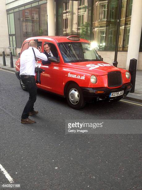 Chancellor of the Exchequer George Osbourne poses for a photographer in a Sun Newspaper sponsored black cab on June 15 2016 in London England