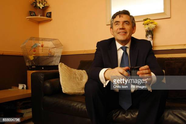 Chancellor of the Exchequer Gordon Brown during a visit to the home of Sally Hatcher a tenant of an ecofriendly community housing development in...