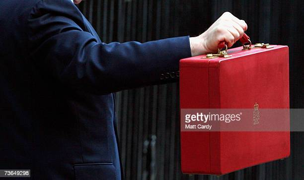 Chancellor of the Exchequer Gordon Brown holds his ministerial red box as he leaves for Parliament to present his 11th budget statemen on March 21...