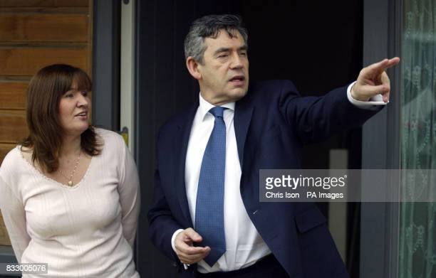 Chancellor of the Exchequer Gordon Brown speaks with Sally Hatcher a tenant of an ecofriendly community housing development during a visit to...