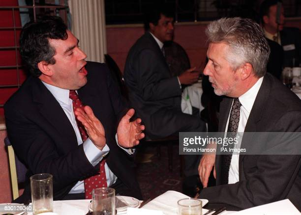 Chancellor of the Exchequer Gordon Brown talks to Chief Executive of BT Sir Peter Bonfield during a business breakfast at London's Regency Hotel...