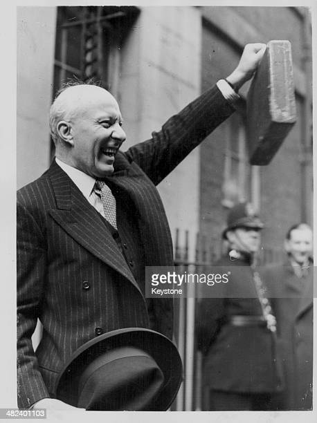 Chancellor of the Exchequer Hugh Dalton holding out a briefcase containing the yearly budget as he leaves 11 Downing Street London April 9th 1946