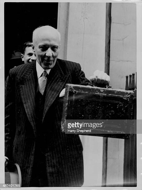 Chancellor of the Exchequer Hugh Dalton holding out a briefcase containing the yearly budget as he leaves 11 Downing Street London April 15th 1947