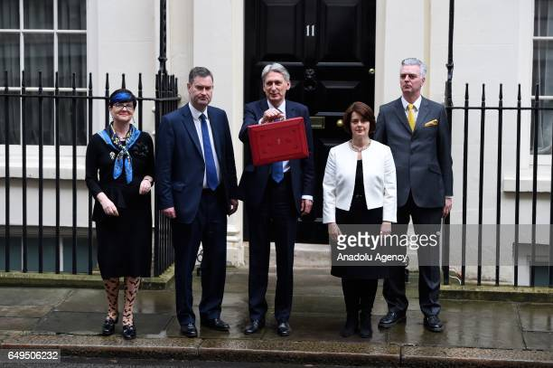 Chancellor of the Exchequer Philip Hammond and members of his ministerial team pose for a photo with the budget box in front of No 11 at Downing...