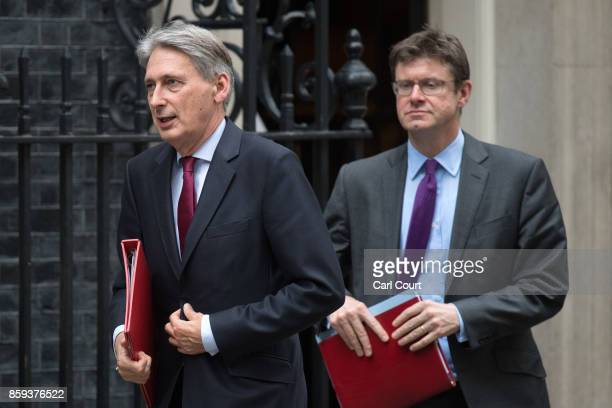 Chancellor of the Exchequer Philip Hammond and Secretary of State for Business Energy and Industrial Strategy Greg Clark leave Downing Street after...