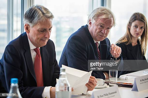 Chancellor of the Exchequer Philip Hammond and the Secretary of State for Exiting the European Union David Davis attend a meeting with executives...