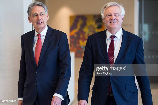 Chancellor of the Exchequer Philip Hammond and the Secretary of State for Exiting the European Union David Davis arrive for a meeting with executives...
