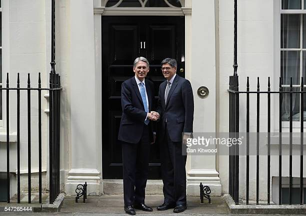 Chancellor of the Exchequer Philip Hammond greets US Secretary of the Treasury Jacob Lew outside 11 Downing Street during his first day in the role...