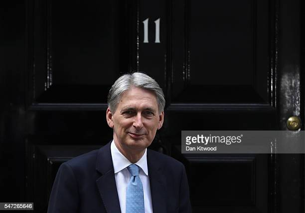 Chancellor of the Exchequer Philip Hammond poses outside 11 Downing Street during his first day in the role on July 14 2016 in London England The...