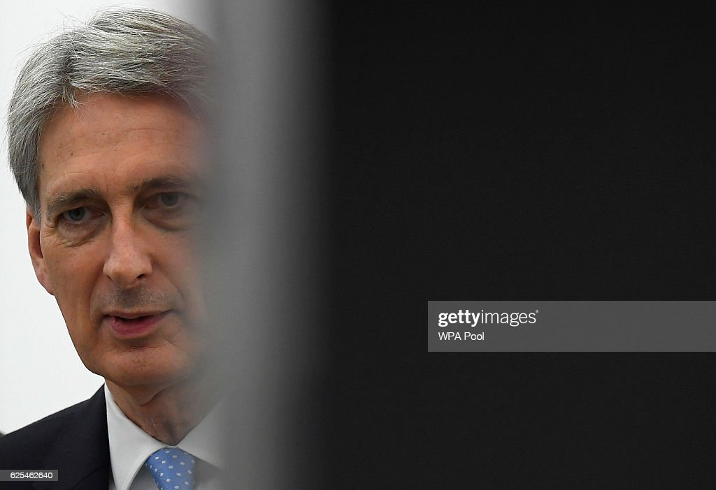 Chancellor of the Exchequer, Philip Hammond tourS the Renishaw innovation and engineering plant on November 24, 2016 in Wootton, England.