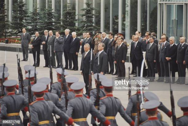 Chancellor of the Federal Republic of Germany Willy Brandt stands on right with Soviet Premier and statesman Alexei Kosygin as they inspect a march...
