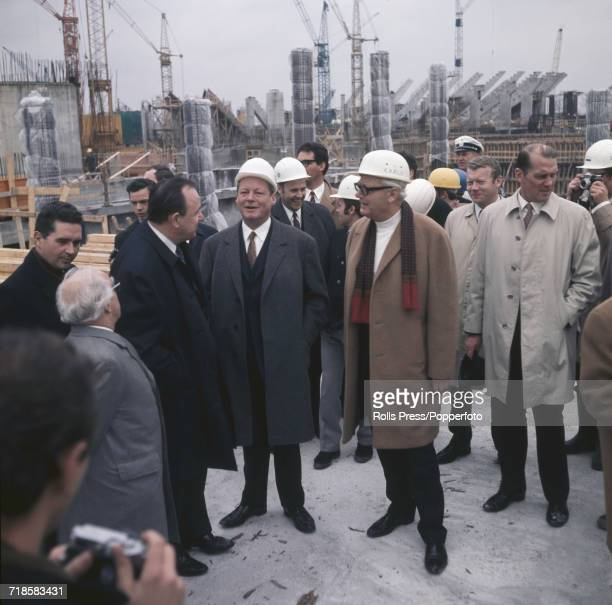 Chancellor of West Germany Willy Brandt pictured in centre of group with Minister of the Interior HansDietrich Genscher on his left as he visits the...