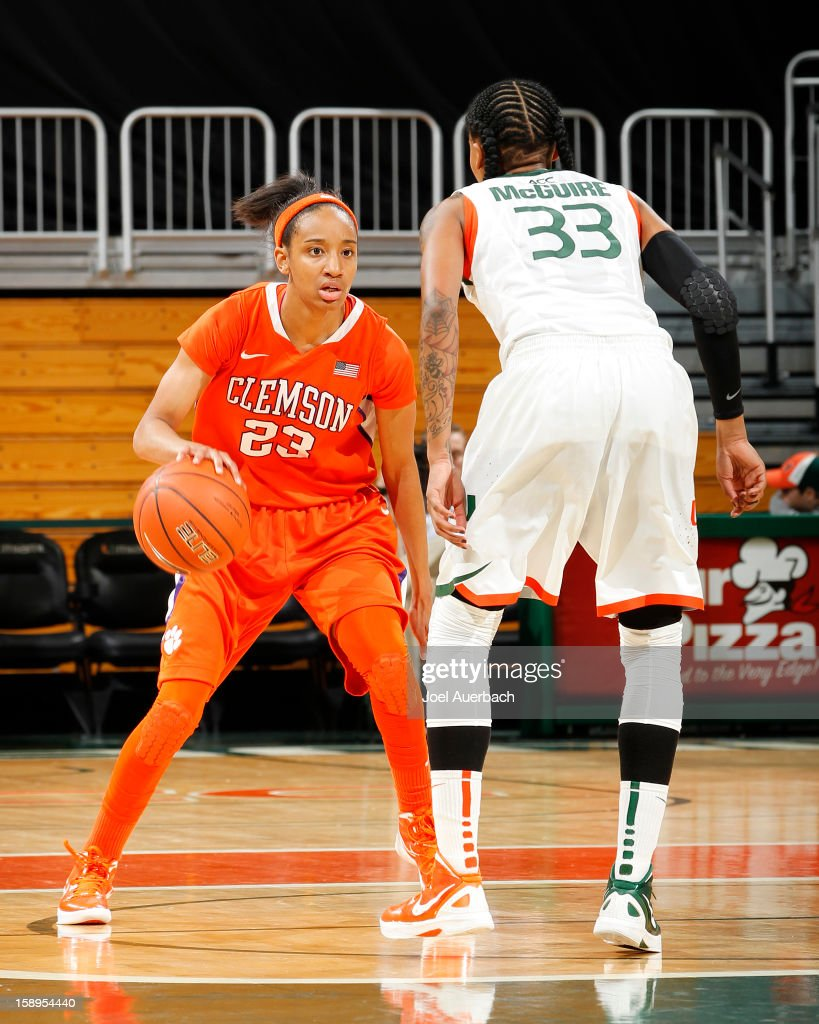 Chancie Dunn #23 of the Clemson Lady Tigers dribbles the ball against Suriya McGuire #33 of the Miami Hurricanes on January 3, 2013 at the BankUnited Center in Coral Gables, Florida. Miami defeated Clemson 78-56.