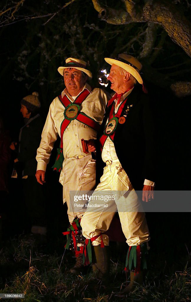 Chanctonbury Ring Morris Men take part in the Apple Howling ceremony at Old Mill Farm on January 5, 2013 in Bolney, England. In this ancient ritual villagers surround the oldest and largest tree in the orchard and evil spirits are driven out and good spirits are encouraged to produce a bountiful apple crop for the following year's cider drink.